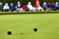 Lawn bowls match with spectators out of focus distant Royalty Free Stock Photography