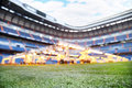 Lawn and lighting system for growing grass at stadium empty outdoor football focus on Stock Photography