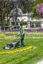 Lawn mover machine prepares the green in Mirabelle Gardens Royalty Free Stock Photo