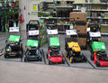 Lawn mower display in a garden store line of petrol mowers for sale the gardening department of large brand new mowers line for Royalty Free Stock Photo