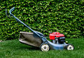 Lawn mower in garden Stock Images