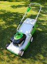 Lawn mower on the grass Royalty Free Stock Photo