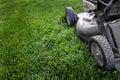 Lawn Mower on Grass Preparing to Mow Royalty Free Stock Photo