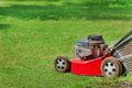 Lawn mower on green grass Royalty Free Stock Photo