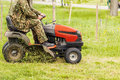 Lawn mower and a man Royalty Free Stock Photo