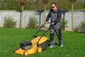 Lawn mower man working on the backyard Royalty Free Stock Photography