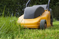 Lawn mowers working on a lawnmowers cut Royalty Free Stock Photos