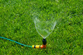 Lawn with Sprinkler Royalty Free Stock Photo