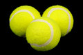 Lawn tennis balls on black background three close up a Royalty Free Stock Photos