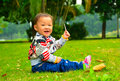The lawn to entertain the girl(Asia, China, Chinese) Royalty Free Stock Photo