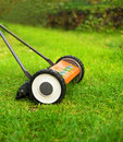 Lawnmower cutting grass Royalty Free Stock Images