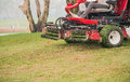 Lawnmower cutting grass , Second cut Lawnmower. Royalty Free Stock Photo