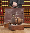 Lawyer with a brown briefcase in the courtroom Royalty Free Stock Images
