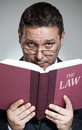 The lawyer close up of in suit holding and reading book Stock Image