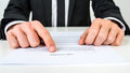 Lawyer explaining terms and conditions closeup of a or a real estate agent proofreading document Stock Images
