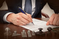 Lawyer notary signs the documents from our office Royalty Free Stock Photo