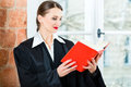 Lawyer in office reading law book young female working her a typical Royalty Free Stock Photo