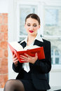 Lawyer in office reading law book young female working her a typical Royalty Free Stock Photography