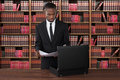 Lawyer With Papers And Briefcase At Desk Royalty Free Stock Photo
