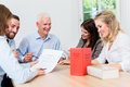 Lawyers in meeting negotiating agreement and reading documents Royalty Free Stock Photo
