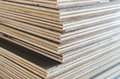 Layer of plywood in construction site as background Royalty Free Stock Photo