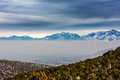 Layer of smog settling over the city inversion visible this is the south end the salt lake county looking north east Stock Image