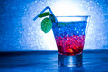 Layered cocktail with blue and red at the club Royalty Free Stock Photography