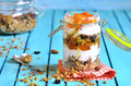 Layered dessert from granola yogurt persimmon and honey in a glass jar Royalty Free Stock Photography