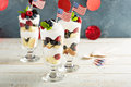 Layered dessert parfait with sweet bread and berries