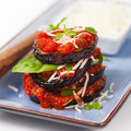 Layered italian eggplant appetizer on white background selective focus Stock Images