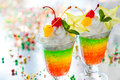 Layered sparkling jelly dessert with cream and fruits for holiday Stock Photos