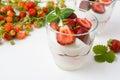 Layered strawberry dessert with yogurt on white background Royalty Free Stock Photo