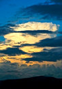 Layers of clouds in front of the sun after storm Royalty Free Stock Photo