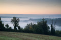 Layers of fog over autumn agricultural landscape foogy fields with Stock Photo