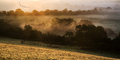 Layers of fog over autumn agricultural landscape foogy fields with Royalty Free Stock Images