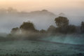 Layers of fog over autumn agricultural landscape foogy fields with Stock Photography
