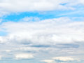 Layers of white cumulus clouds in blue autumn sky Royalty Free Stock Photo