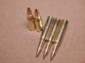 The laying cartriges 308 Winchester caliber with full metal jacket bullets steel case Royalty Free Stock Photo