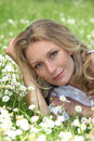 Laying of a flower field woman Royalty Free Stock Image