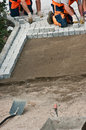 Laying paving bricks on soil Royalty Free Stock Photography
