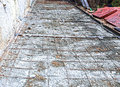 Laying of paving slabs on cement base Stock Photo
