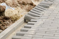Laying of paving slabs to curb the Royalty Free Stock Photo
