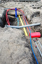 Laying of underground cables and pipes in the residential const Royalty Free Stock Photo