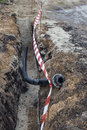 Laying water pipes in a trench 3 Royalty Free Stock Photo