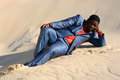Lazy businessman laying in sand full body of a african american with depressed facial expression the Royalty Free Stock Photography