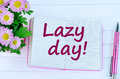 Lazy day words on notebook Royalty Free Stock Photo