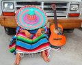 Lazy nap mexican guy sleeping on grunge car Royalty Free Stock Image