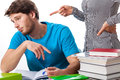 Lazy student with angry teacher warning a to study more Royalty Free Stock Images