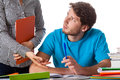 Lazy student being warned by a teacher at college for not working during class Stock Image