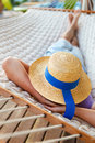 Lazy time man in hat in a hammock on a summer day Royalty Free Stock Photos